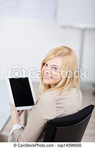 businesswoman holding tablet-pc in the office - csp14396656