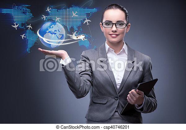 Businesswoman in air travel concept - csp40746201
