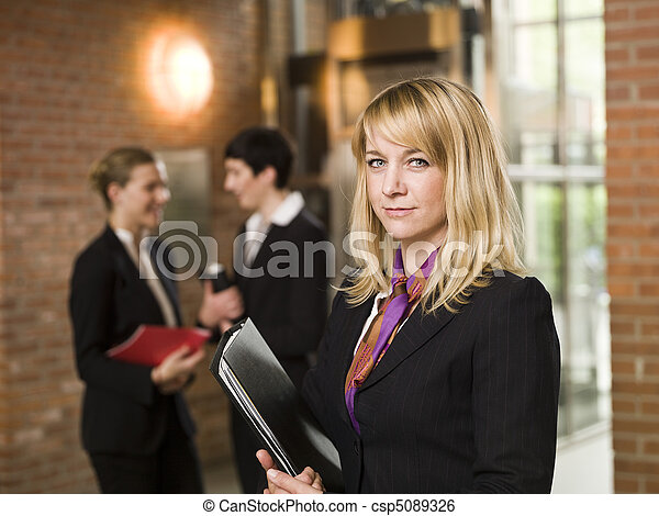 Businesswoman in front of two women - csp5089326