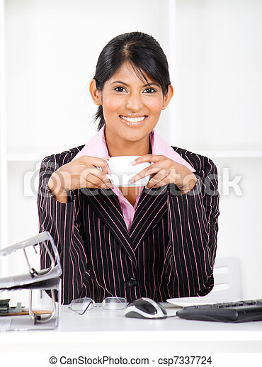 businesswoman in office with coffee - csp7337724