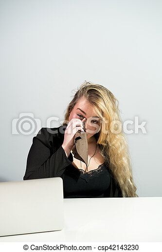 Businesswoman in office with laptop computer - csp42143230