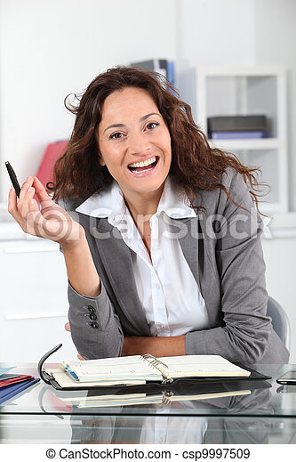 Businesswoman in the office - csp9997509