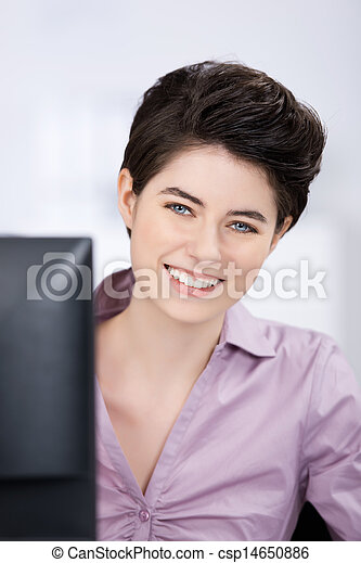 Businesswoman Looking At Camera In Office - csp14650886