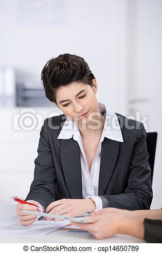 Businesswoman Looking At Digital Tablet - csp14650789