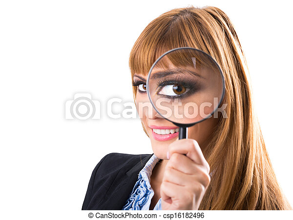 Businesswoman looking through magnifying glass - csp16182496