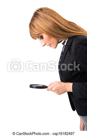 Businesswoman looking through magnifying glass - csp16182497