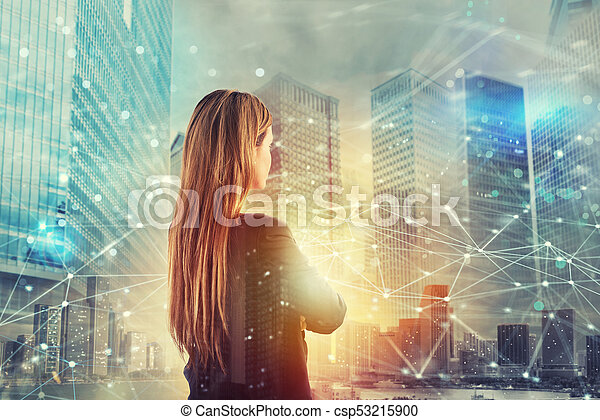 Businesswoman looks far for the future with internet network effect - csp53215900