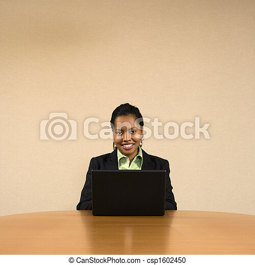 Businesswoman on computer. - csp1602450
