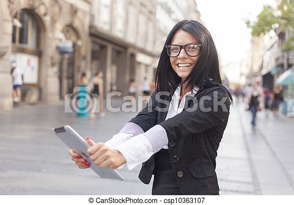 Businesswoman on street with tablet computer - csp10363107