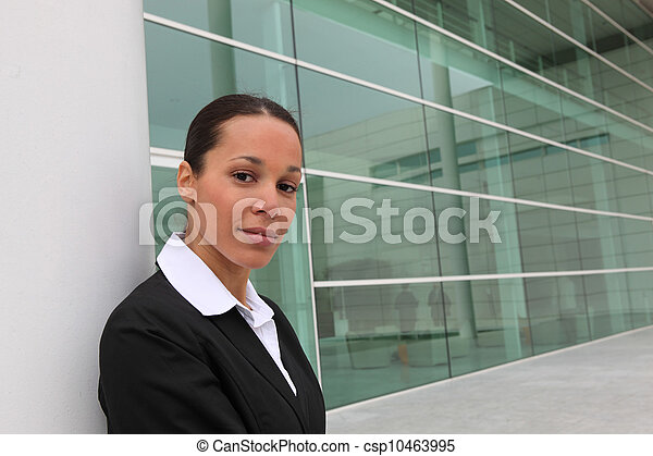 Businesswoman outside office block - csp10463995