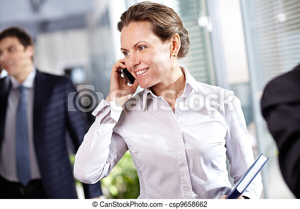 Businesswoman phoning - csp9658662