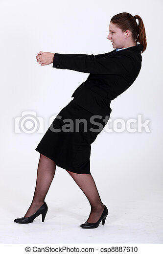 Businesswoman pulling an invisible object - csp8887610