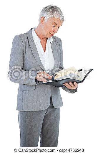 Businesswoman reading her diary - csp14766248