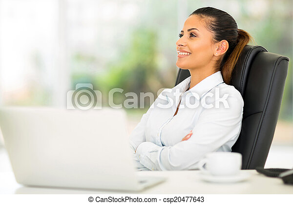 businesswoman relaxing at office - csp20477643