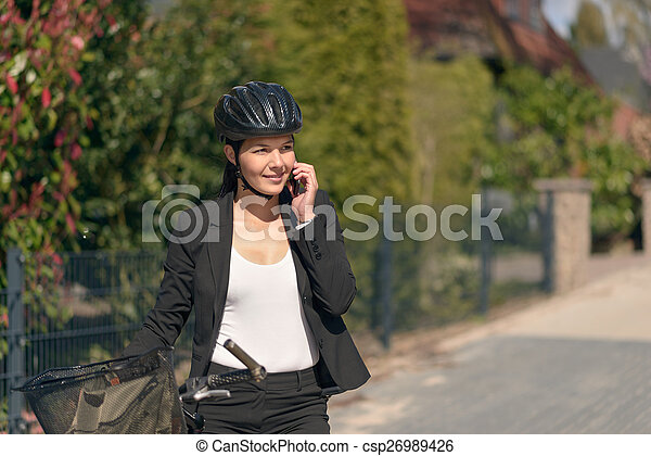 Businesswoman riding to work pausing for a call - csp26989426