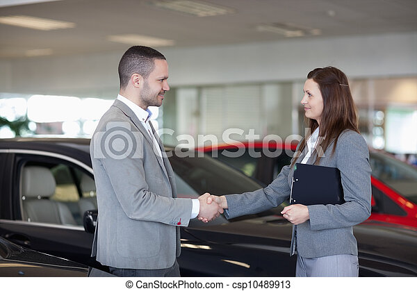 Businesswoman shaking hand of a man - csp10489913