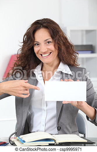 Businesswoman showing business card - csp9995971