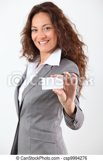 Businesswoman showing business card - csp9994276