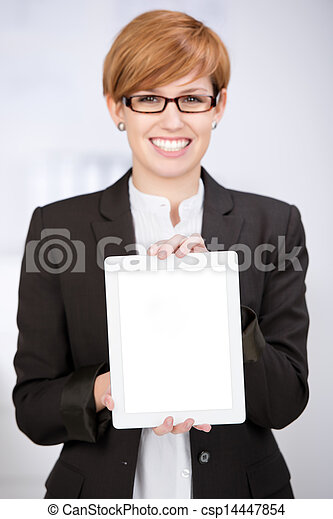 Businesswoman Showing Digital Tablet In Office - csp14447854