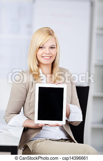 Businesswoman Showing Digital Tablet While Sitting In Office - csp14396661