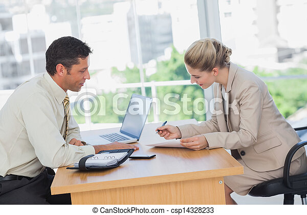 Businesswoman signing contract at interview - csp14328233