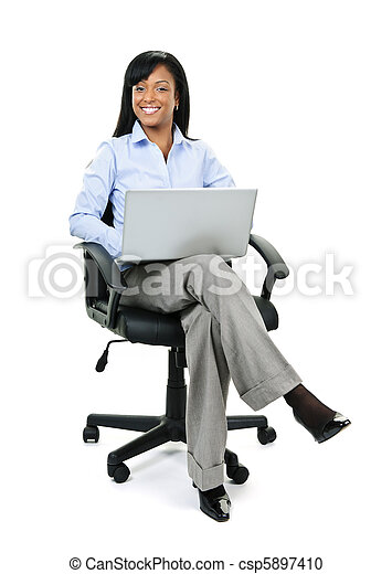 Businesswoman sitting in office chair with computer - csp5897410