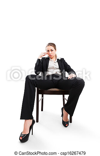 Businesswoman sitting on a chair isolated on white - csp16267479