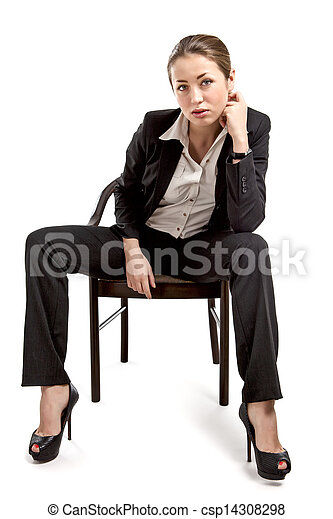 Businesswoman sitting on a chair isolated on white - csp14308298