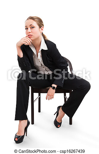 Businesswoman sitting on a chair isolated on white - csp16267439