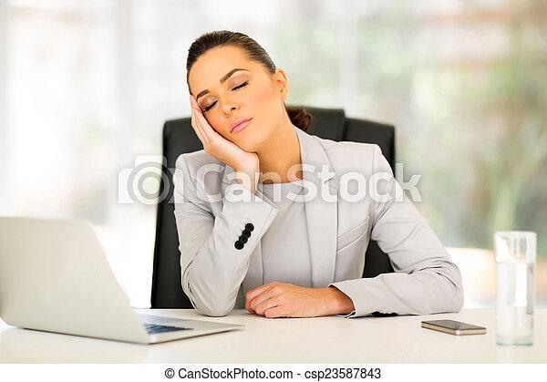businesswoman sleeping in office - csp23587843
