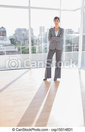 Businesswoman standing in office - csp15014831