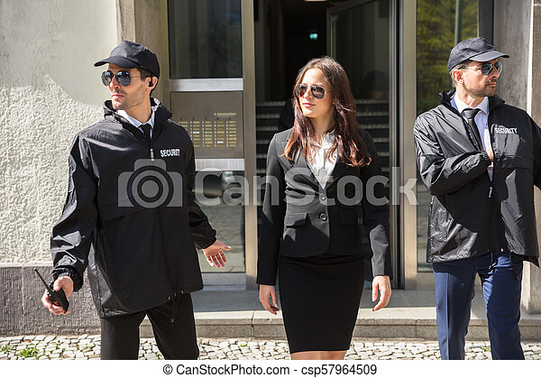 Businesswoman Stepping Out From Office Building - csp57964509