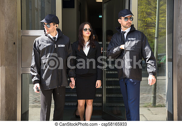 Businesswoman Stepping Out From Office Building - csp58165933