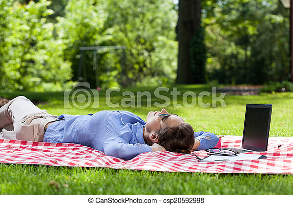 Businesswoman taking a break from work outdoors - csp20592998