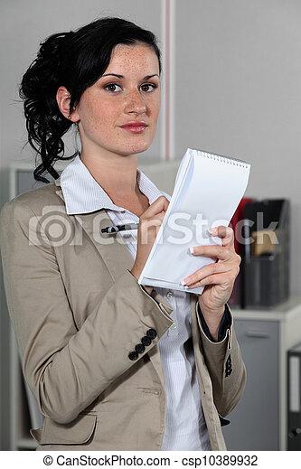 Businesswoman taking notes - csp10389932