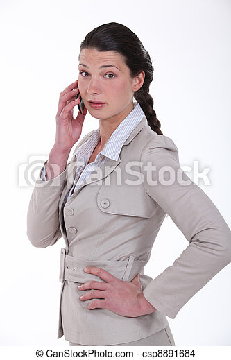 businesswoman talking on her cell - csp8891684