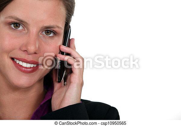 Businesswoman using a cellphone - csp10950565