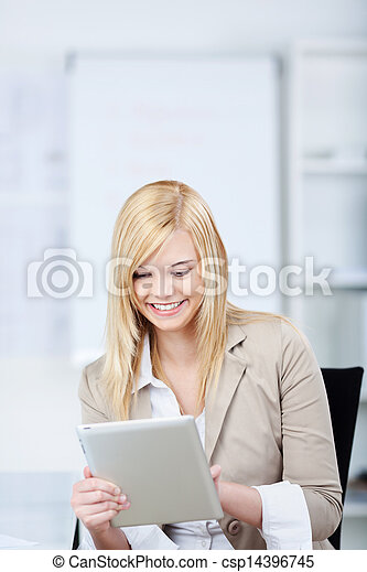 Businesswoman Using Digital Tablet In Office - csp14396745