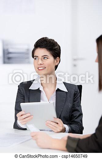 Businesswoman Using Digital Tablet In Meeting - csp14650749