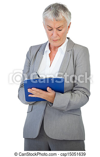 Businesswoman using her clipboard  - csp15051639