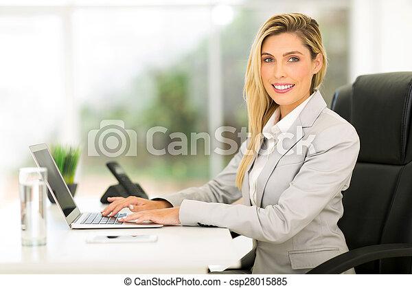 businesswoman using laptop computer - csp28015885