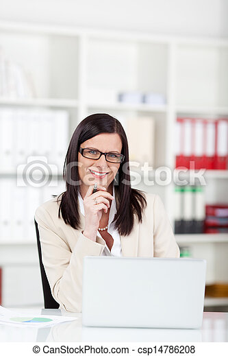 Businesswoman wearing glasses with a laptop - csp14786208