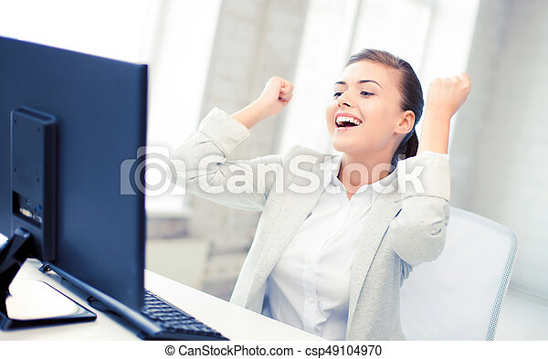 businesswoman with computer in office - csp49104970