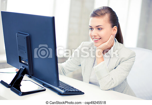 businesswoman with computer in office - csp49245518