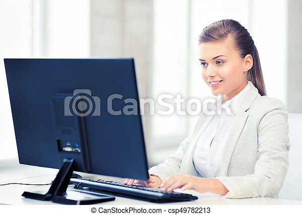 businesswoman with computer in office - csp49782213