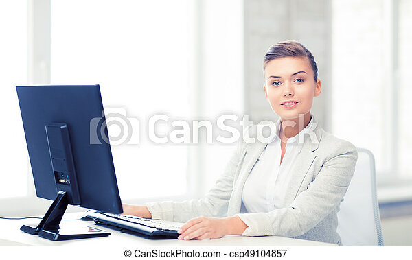 businesswoman with computer in office - csp49104857