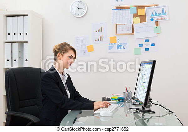 Businesswoman With Computer In Office - csp27716521