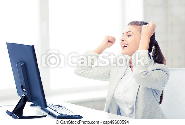 businesswoman with computer in office - csp49600594