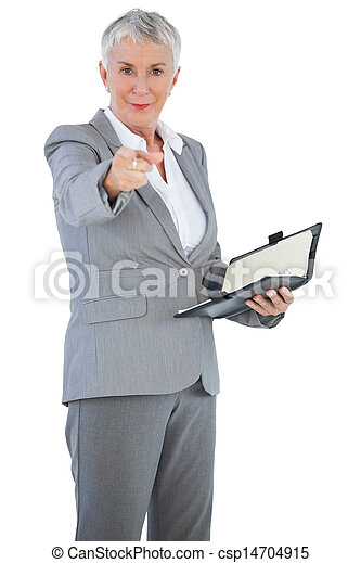 Businesswoman with diary pointing her finger at camera - csp14704915