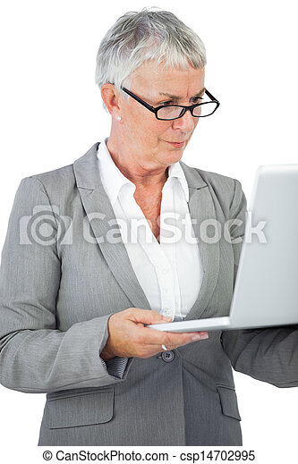 Businesswoman with glasses watching her laptop  - csp14702995